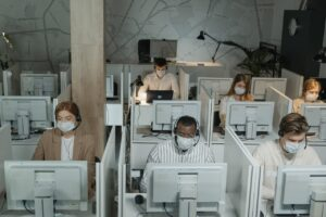 Socially distanced workers in office